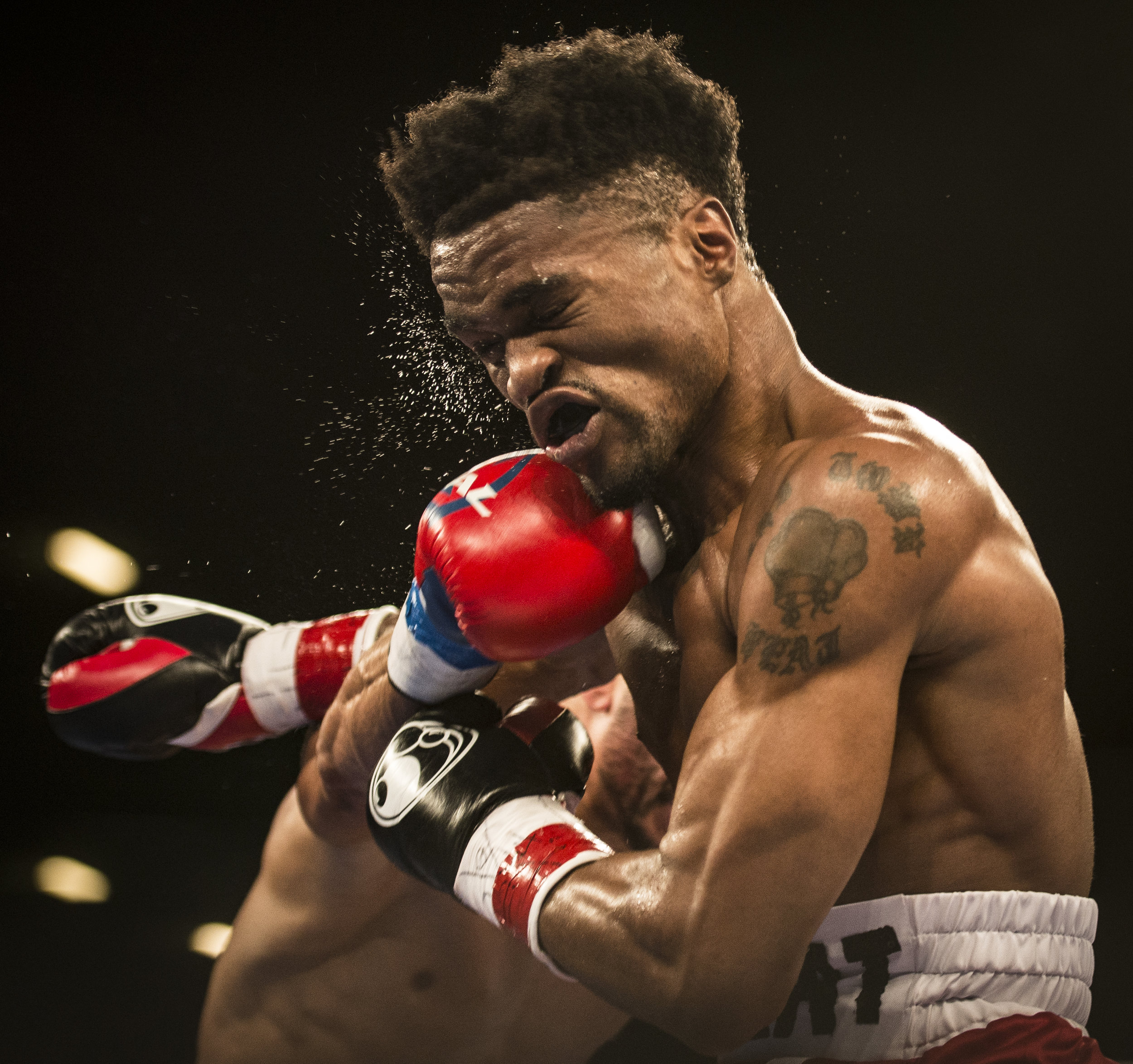 Alex Martin receives a hard punch by Robert Daniels Jr. during their bout at Hialeah Casino Park.