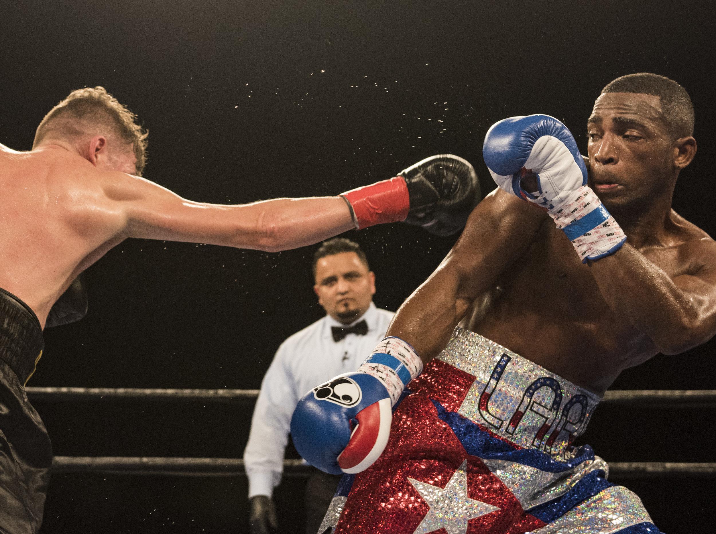 Cuban boxer Erislandy Lara dodges a punch from Yuri Foreman during their fight at Hialeah Casino Park.
