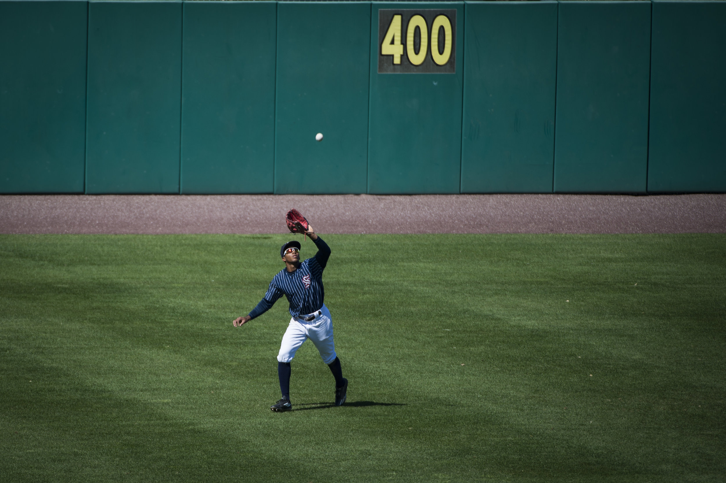 "Rafael Bautista catches a fly ball during the Syracuse Chiefs game against the Norfolk Tides on April 23rd, 2017. ""He's an outstanding outfielder, runs exceptionally well, has a good throwing arm and he pays attention, that's what I like most about him, is that he pays attention,"" said Dusty Baker, the manager for the Washington Nationals after Bautista was promoted to the majors."