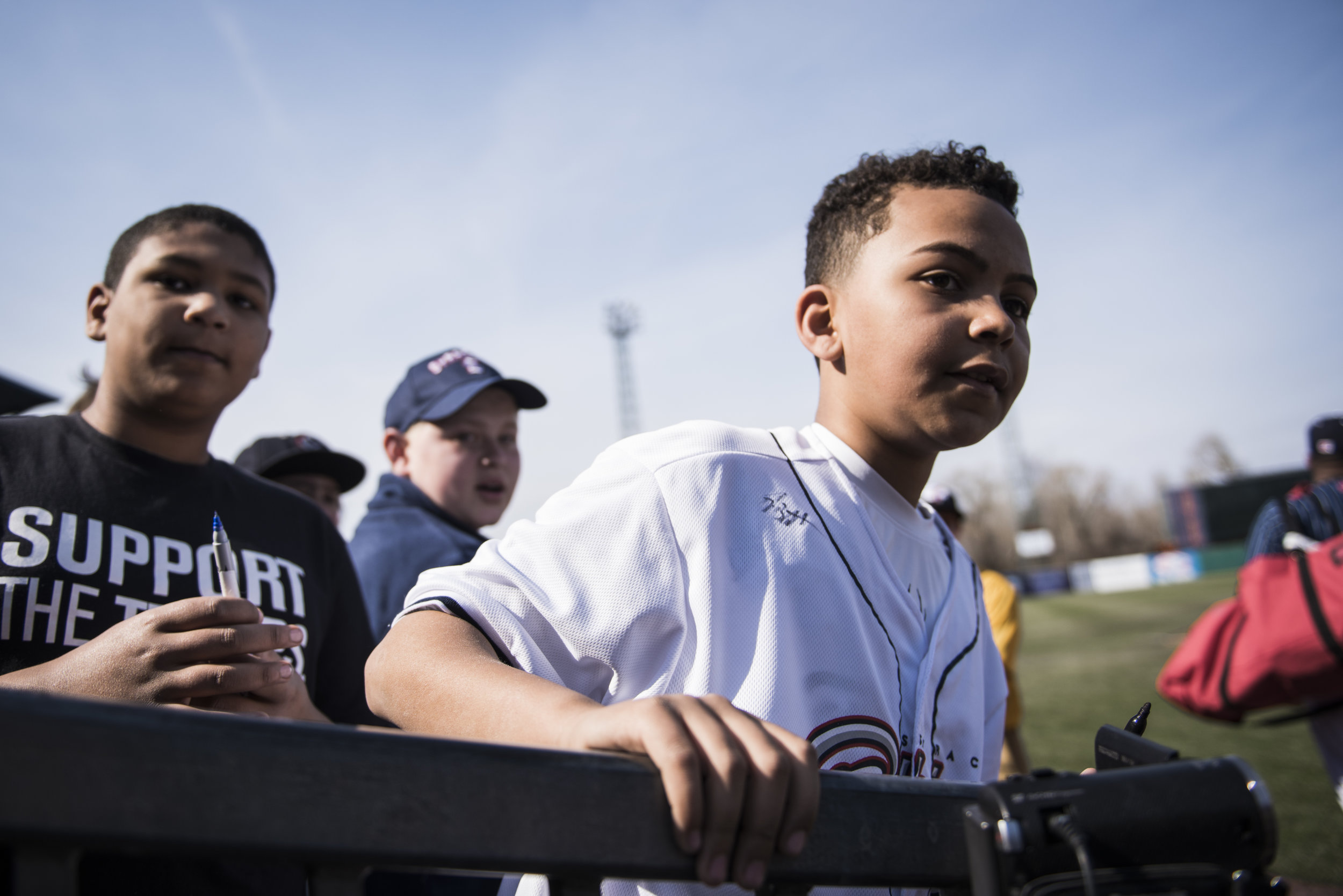Young fans wait for Syracuse Chiefs players to come sign memorabilia ranging from old jerseys to baseball cards, before the Chiefs game against the Rochester Red Wings on April 9th, 2017.