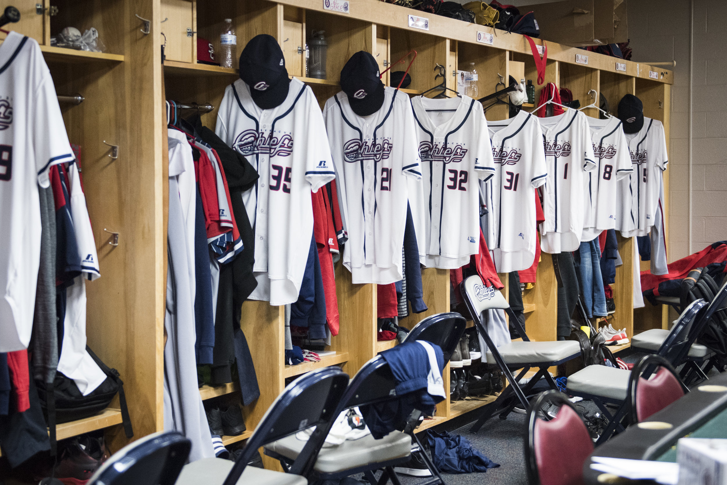 The Syracuse Chiefs locker room before a game against the Norfolk Tides on April 23rd, 2017. Rafael Bautista's number 8 jersey hangs in front of his locker.
