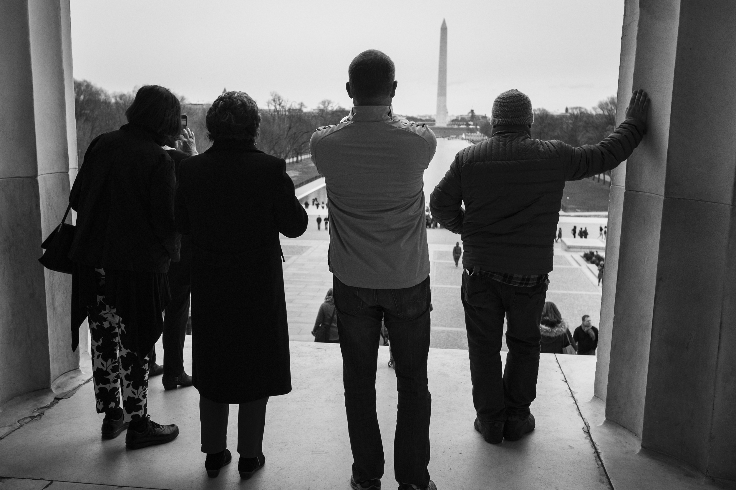 Tourists take photos of the National Mall.