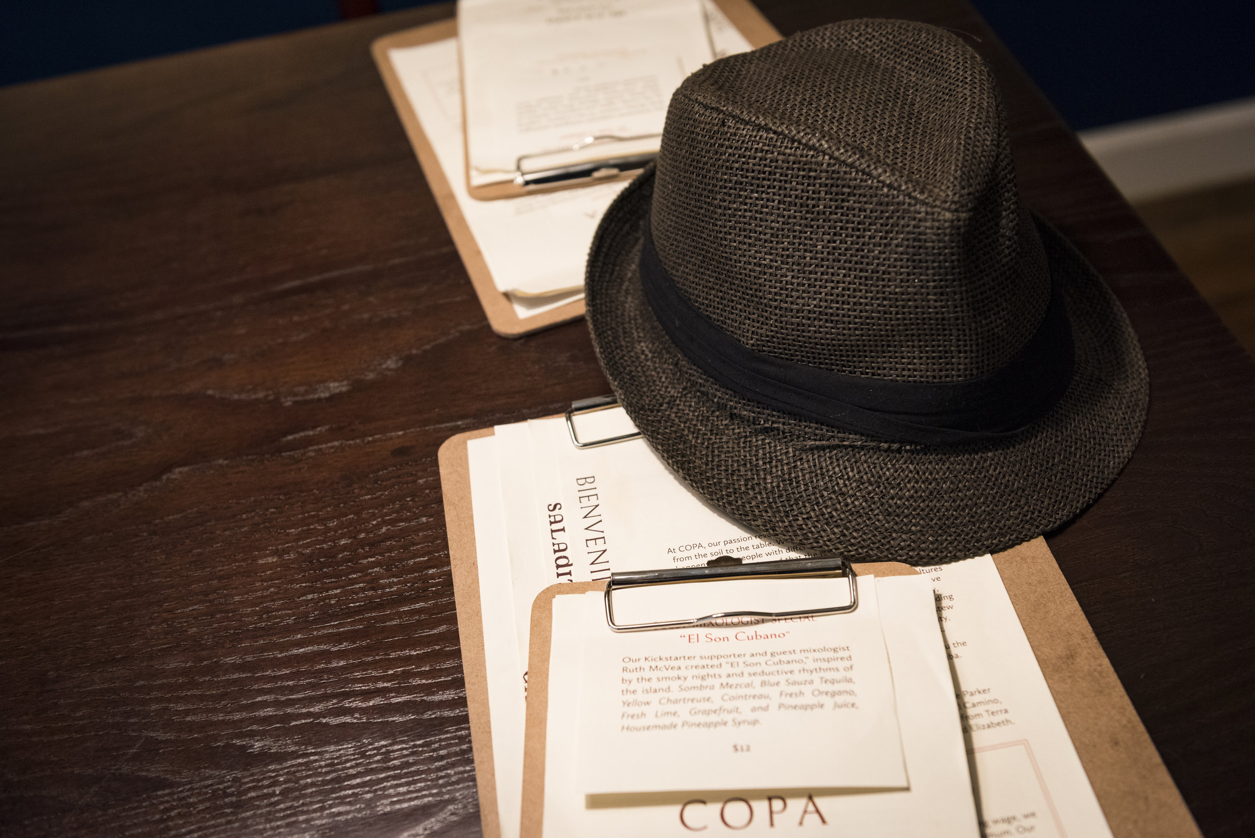 """Roberto's hat sits on a table while he eats. """"The law makes us wear something on our heads while we are in the kitchen and I thought I would wear something that fit the theme of the restaurant,"""" said Matos about his choice of wearing the traditional hat."""