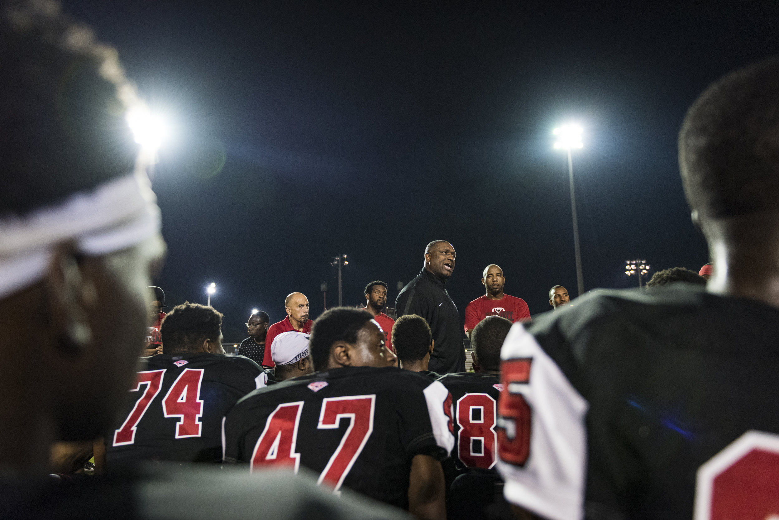 Southern Durham head coach Darius Robinson addresses his team after a big win against the the No. 4 team, Seventy-First High School. The Spartans scored nine points in the final 78 seconds of the game to finish the upset, 36-32.