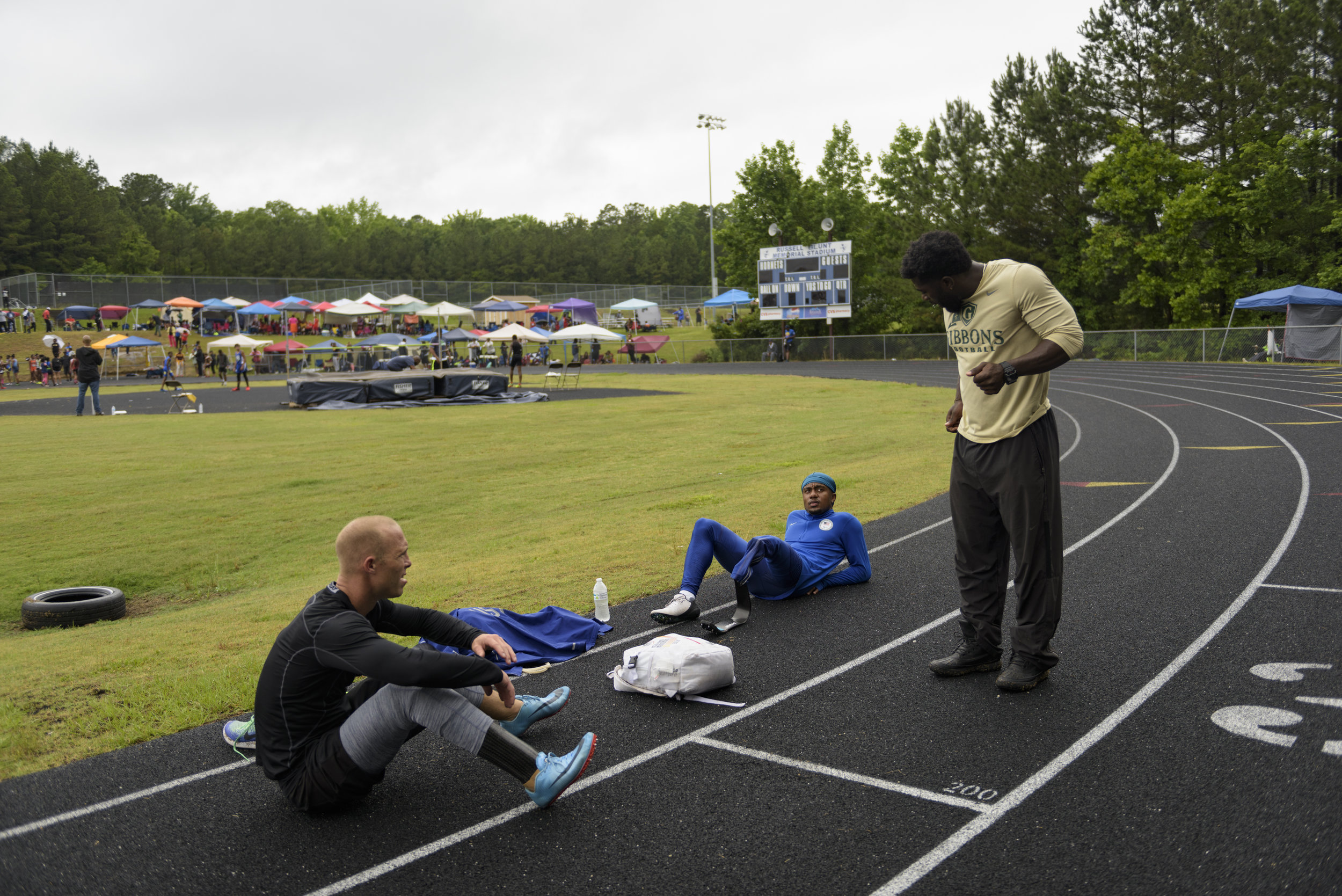 U.S. Paralympian Desmond Jackson receives final instructions from his coach before his race in Durham, NC on June 8, 2019.