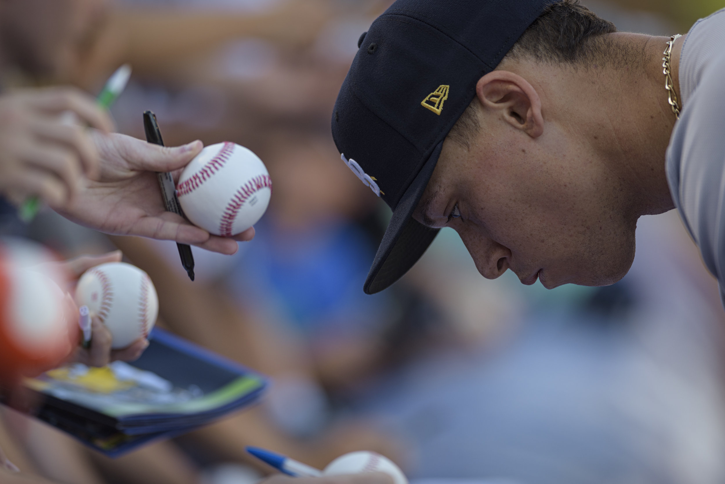 New York Yankees outfielder Aaron Judge signs autographs after batting practice with the Wilkes-Barre RailRiders, the Yankees' Triple-A affiliate, on June 14, 2019 at Durham Bulls Athletic Park in Durham, NC. Judge was playing with the RailRiders on a rehab assignment.