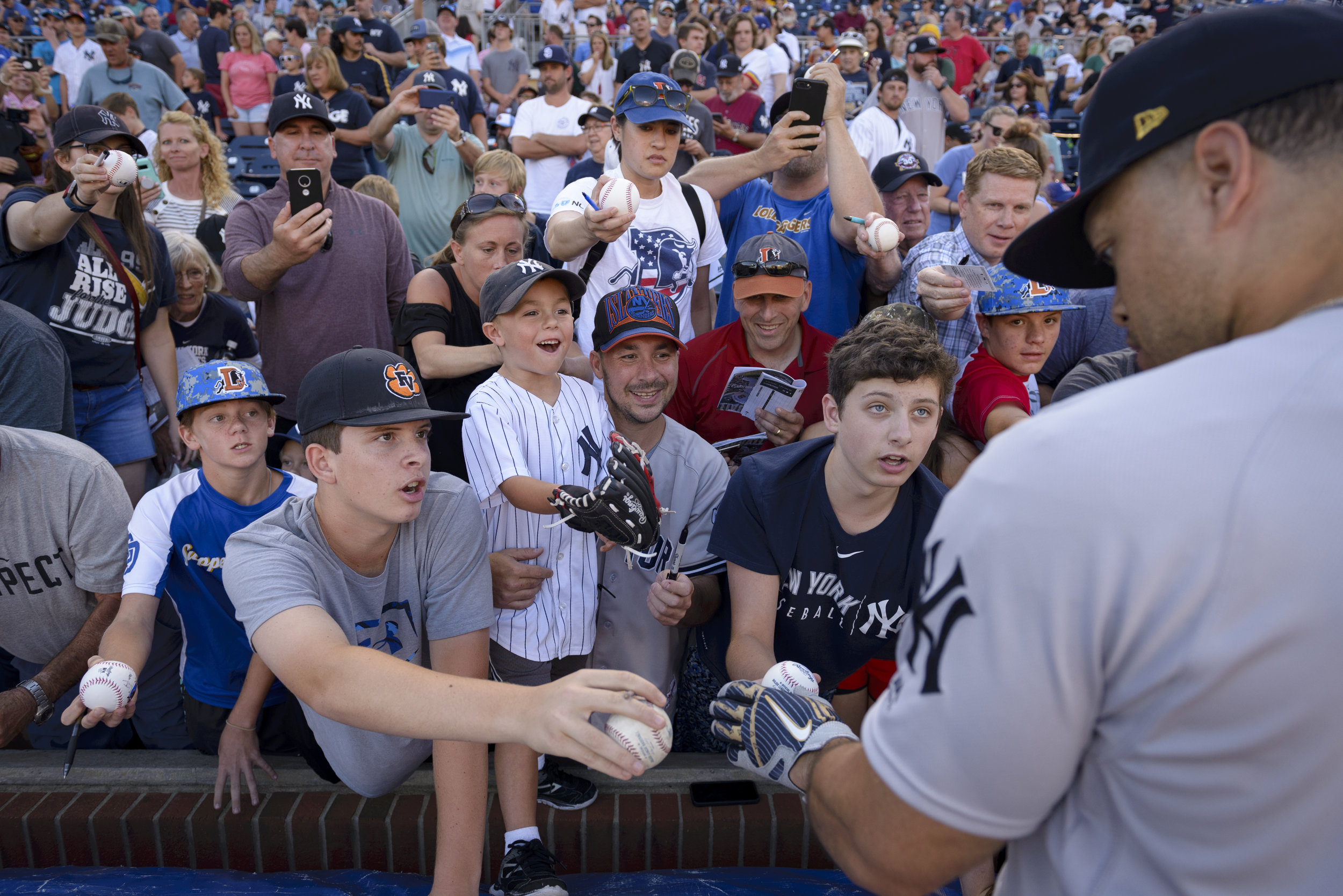 New York Yankees outfielder Giancarlo Stanton signs autographs after batting practice with the Wilkes-Barre RailRiders, the Yankees' Triple-A affiliate, on June 14, 2019 at Durham Bulls Athletic Park in Durham, NC.