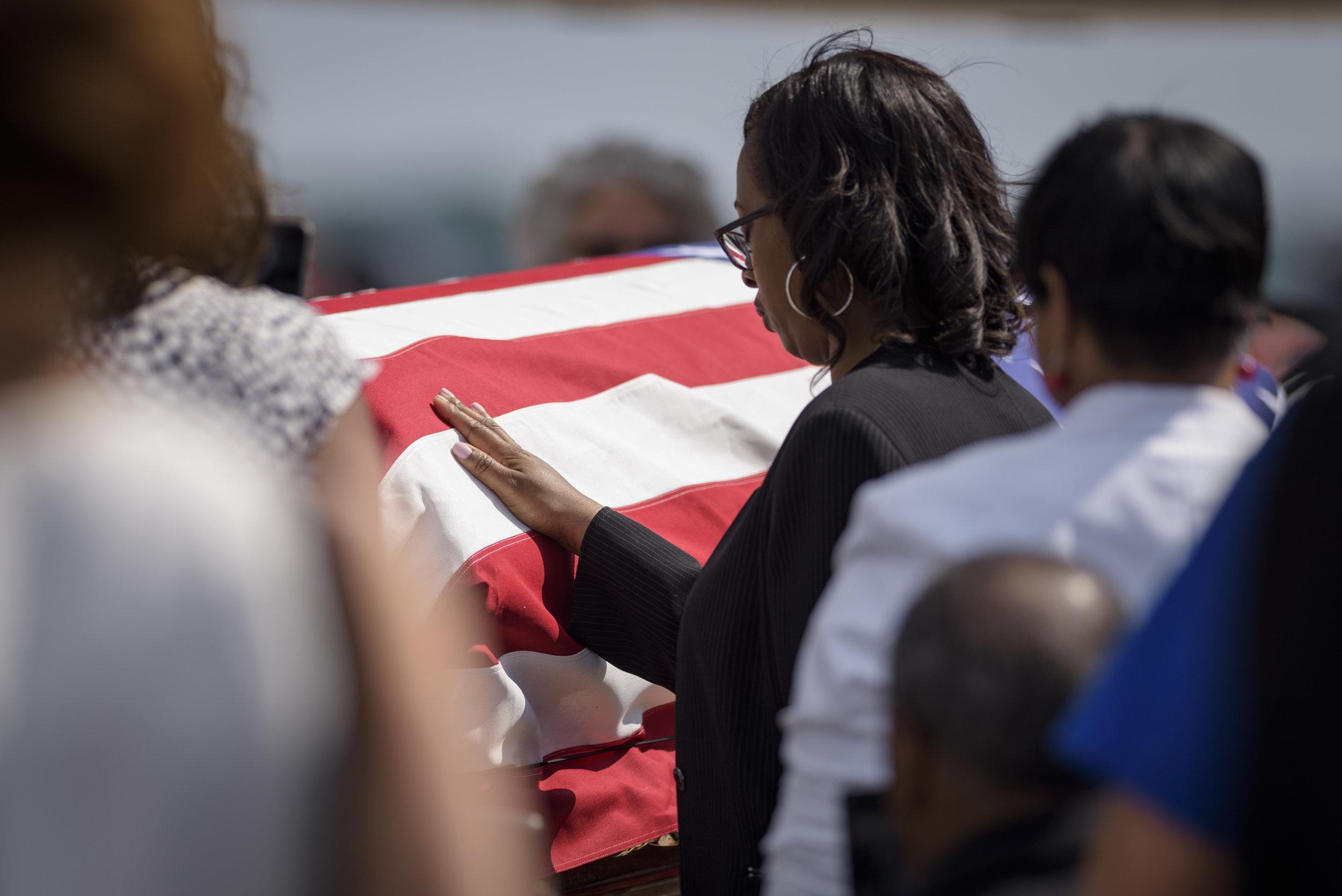 Family members of Army Pfc. William H. Jones commemorate him at RDU Airport in Raleigh, NC on June 20, 2019.