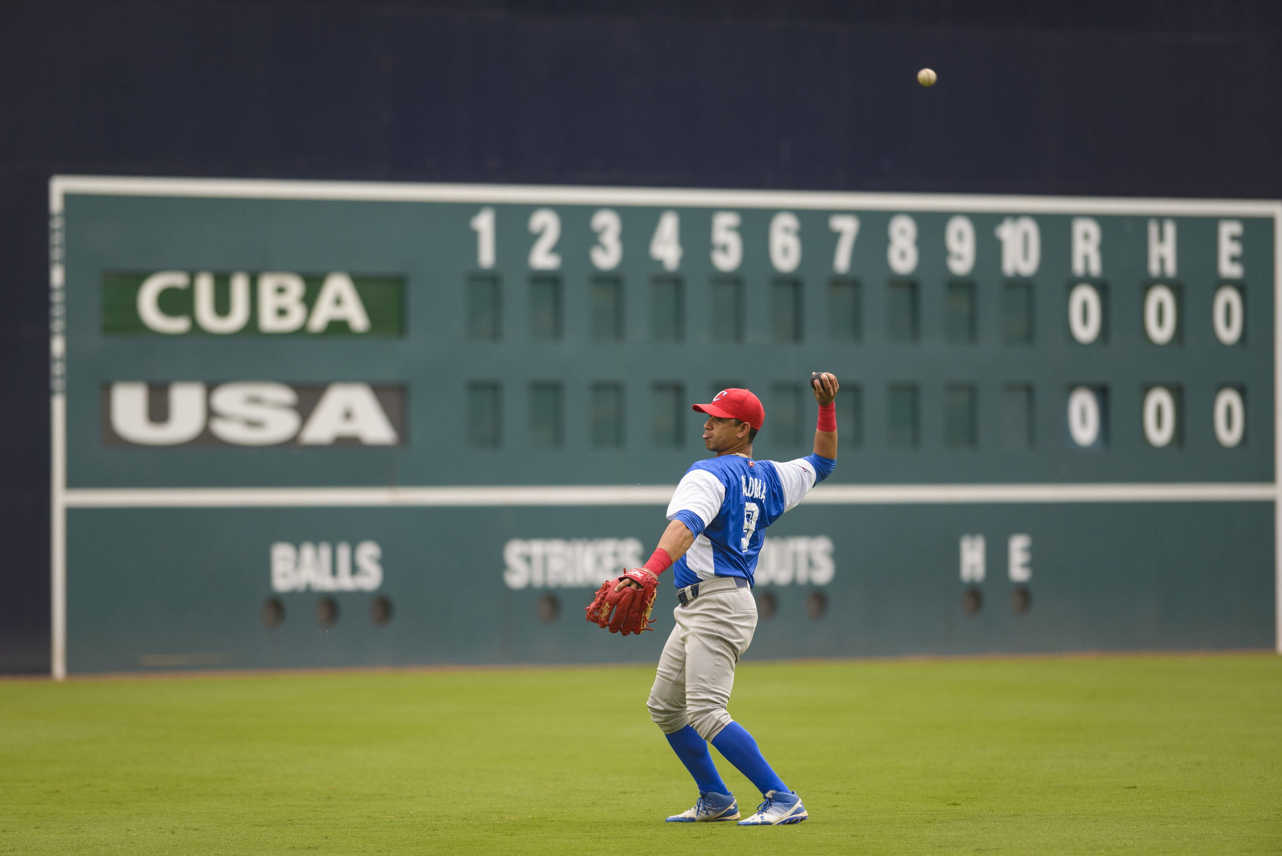 Cuban shortstop Jorge Enrique Aloma (9) warms up before Cuba's game against the USA Baseball Collegiate National Team on July 4, 2019 at Durham Bulls Athletic Park in Durham, NC.