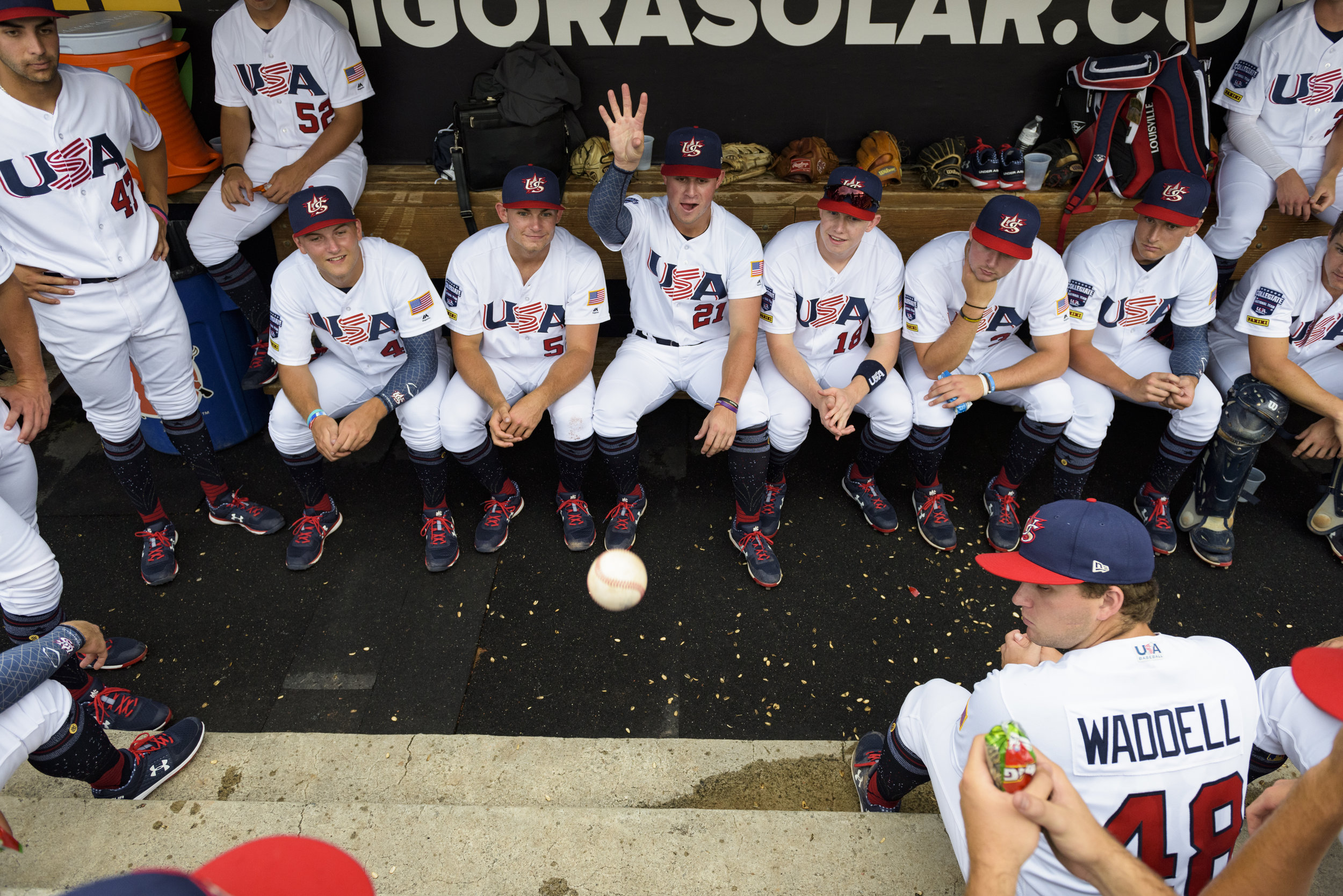 Team USA players pass time in the dugout during a rain delay on July 4, 2019 at Durham Bulls Athletic Park in Durham, NC. The USA Baseball Collegiate National Team was playing Cuba as part of the 8th Annual USA vs. Cuba International Friendship Series.