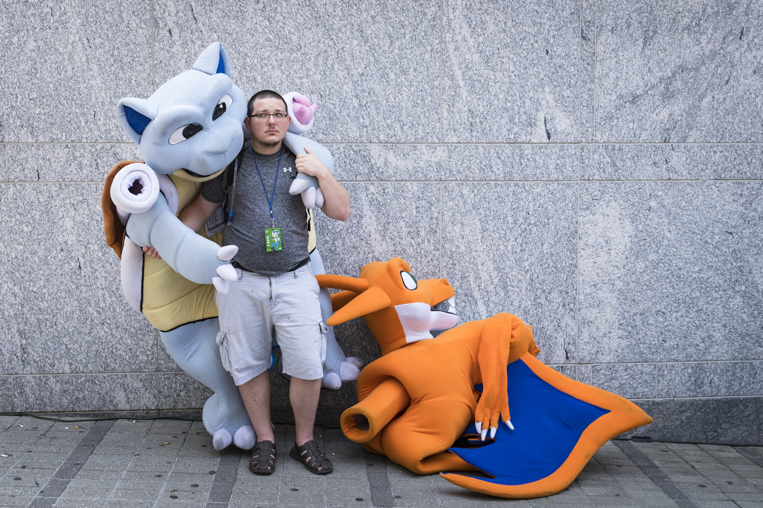 Aaron Hampson stands outside the convention center as he gets ready for lunch after a morning of being dressed up as a Pokemon at GalaxyCon in Raleigh, NC on July 26, 2019.