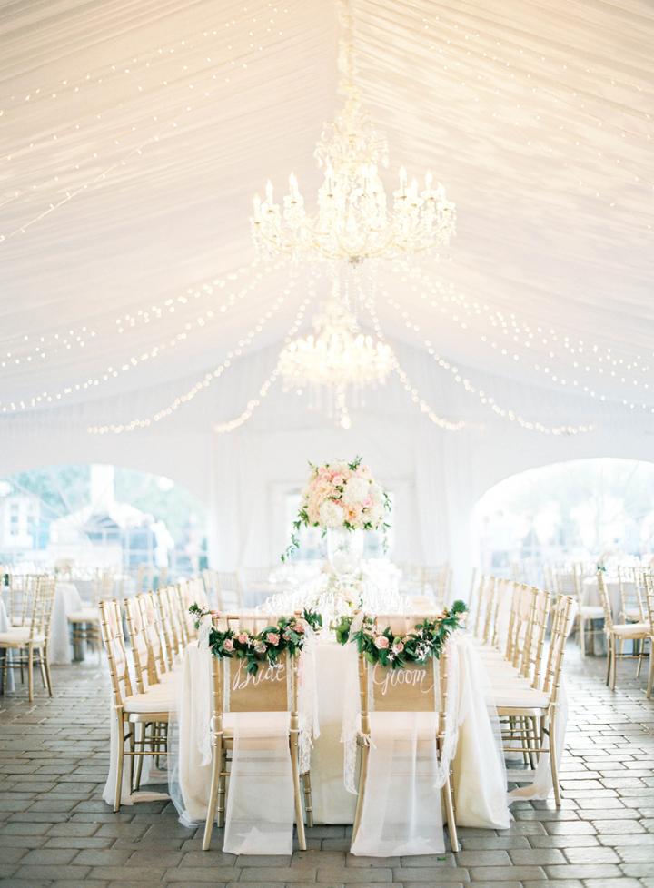 This reception was an absolute STUNNER with the chandeliers under the tent with chiffon and tulle.  I loved the hand painted Bride and Groom chairs that we created for the couple.