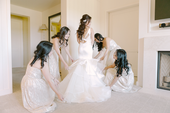 Cathy wore a Hailey Page gown and I loved the back of the dress! She tried on what seemed like more than 100 dresses and this modern piece was the perfect fit!