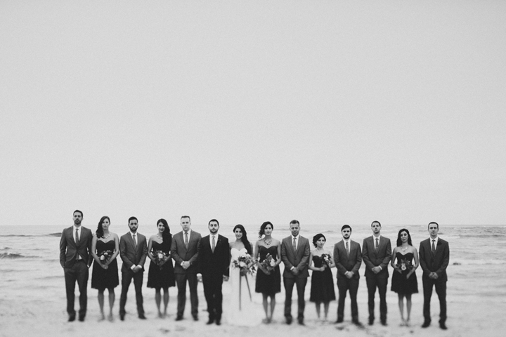 How rad does the wedding party look on the beach?