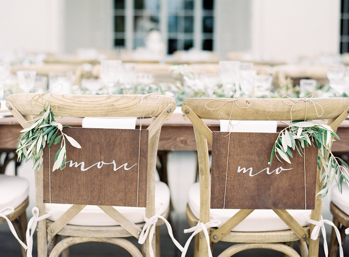 "Amore Mio translates to ""My Love"" in English.  This was perfect for the bride and groom chairs that our team also hand painted."