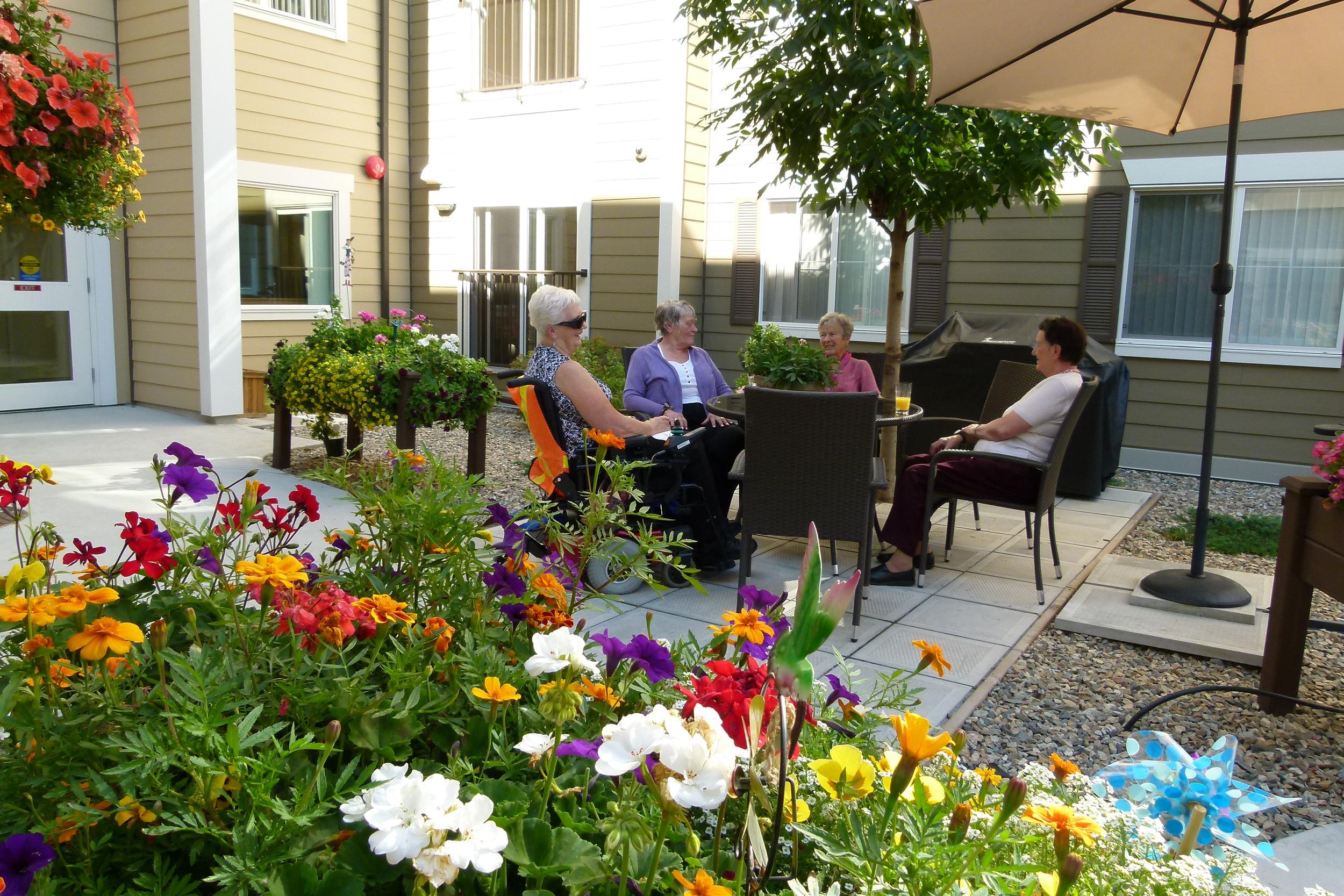 Courtyard 2 Ladies at patio table.JPG