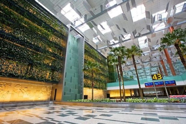 Feeling relaxed? Trees and plants dot the building inside Changi airport, which boasts a five-storey vertical garden with waterfalls. Image via Traveller