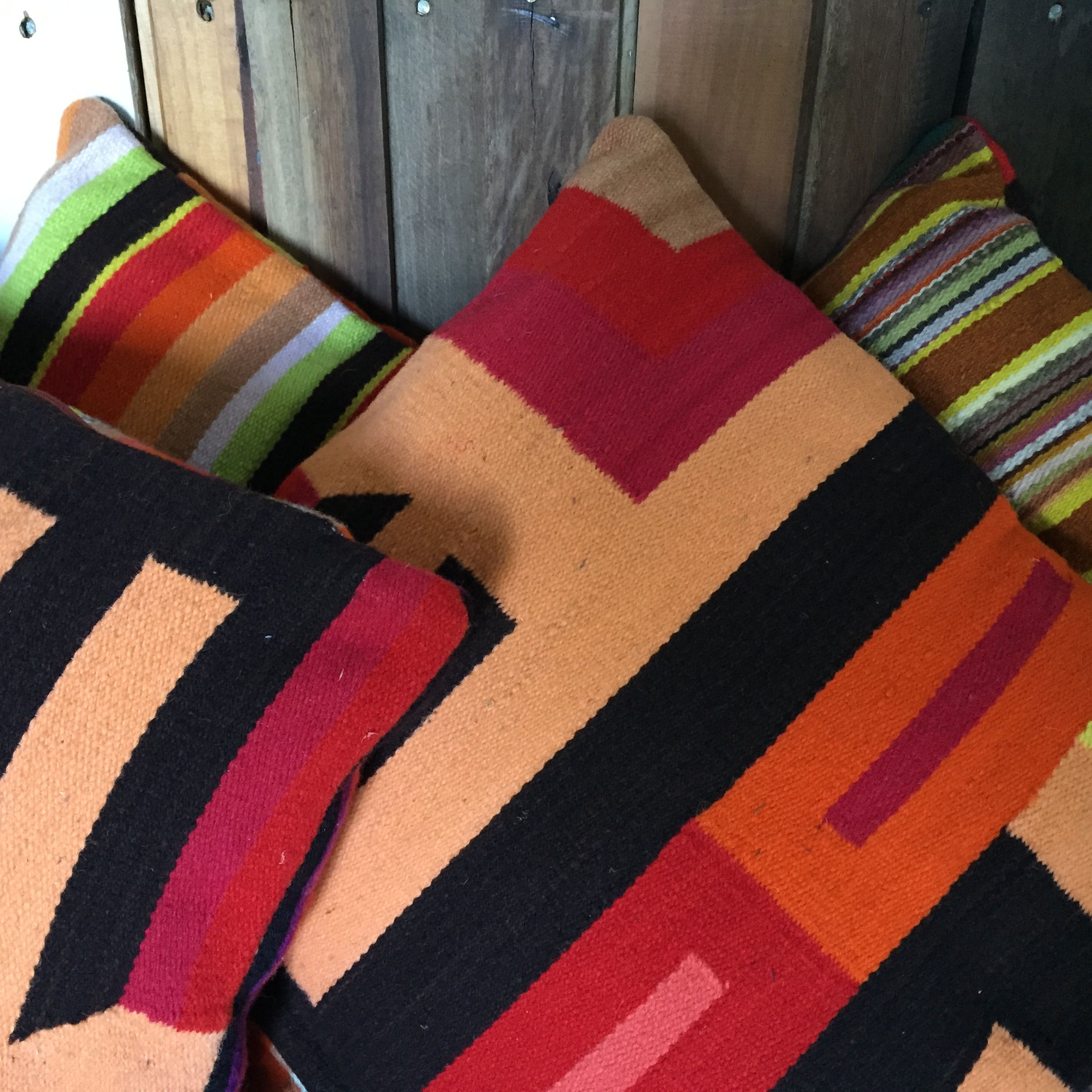 Three different patterns but they're unified by colour and geometric shapes