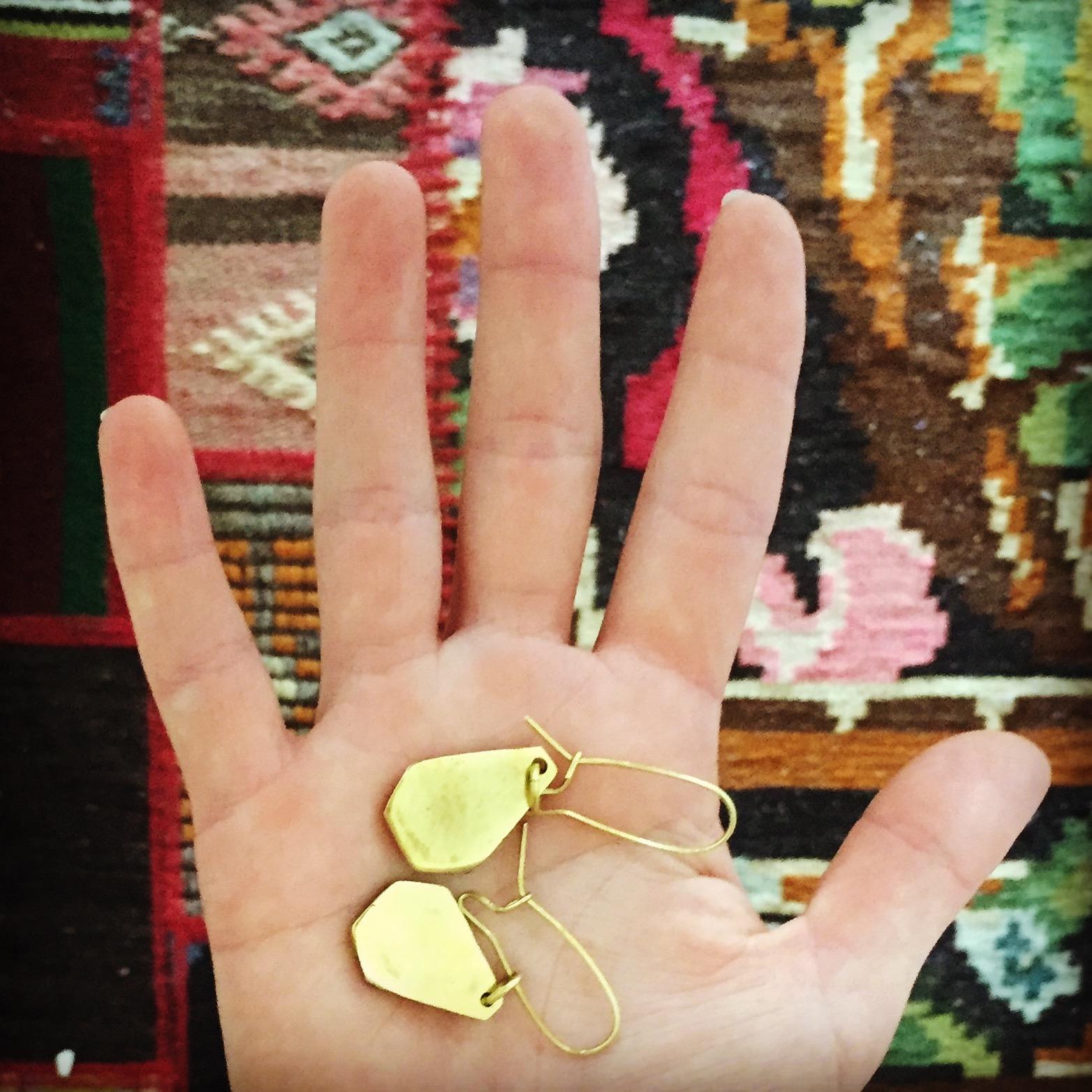 Brass-casted geometric earrings , $38