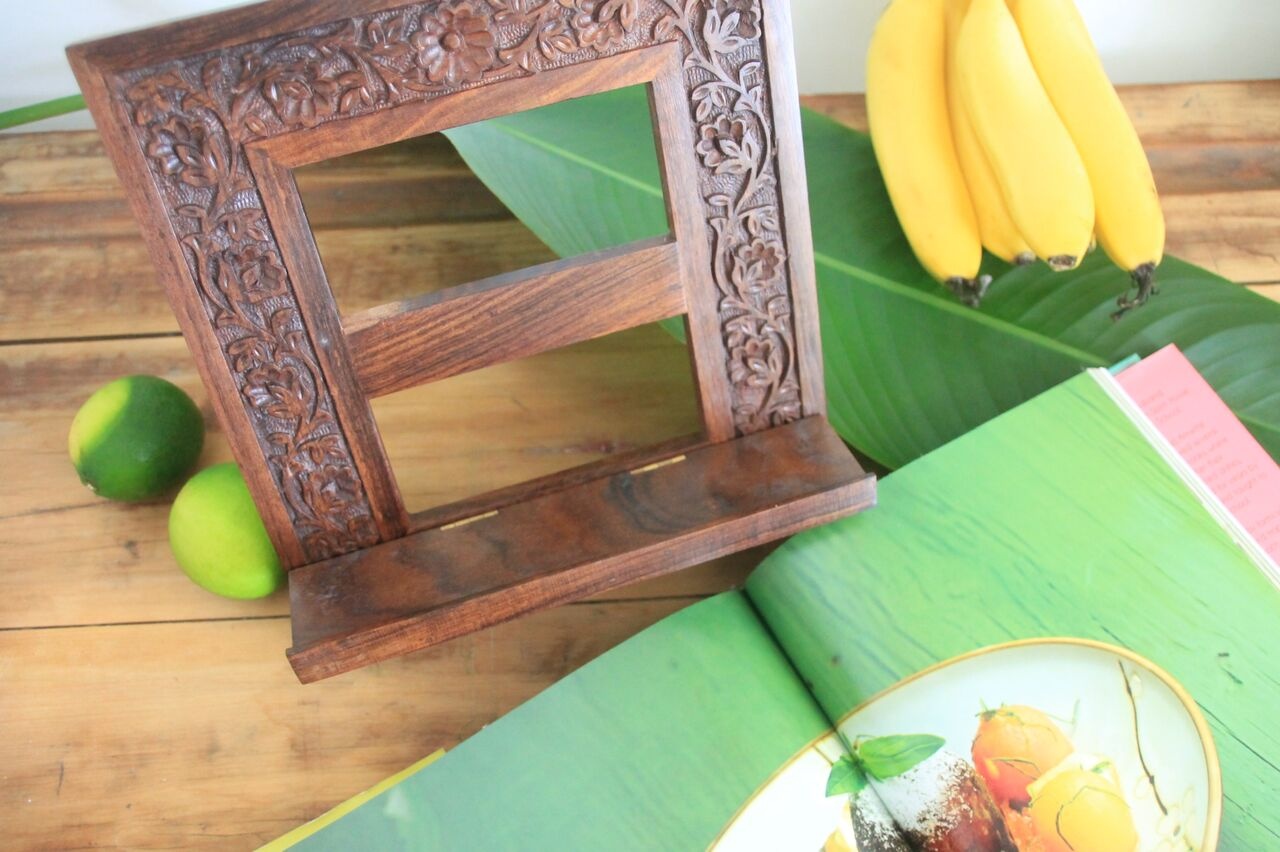 Our beautiful  timber book stand  is handcarved in sheesham wood by the artisans at Aspiration International in India