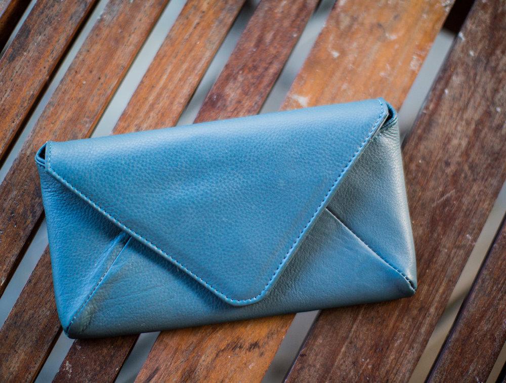 Petrol blue leather clutch