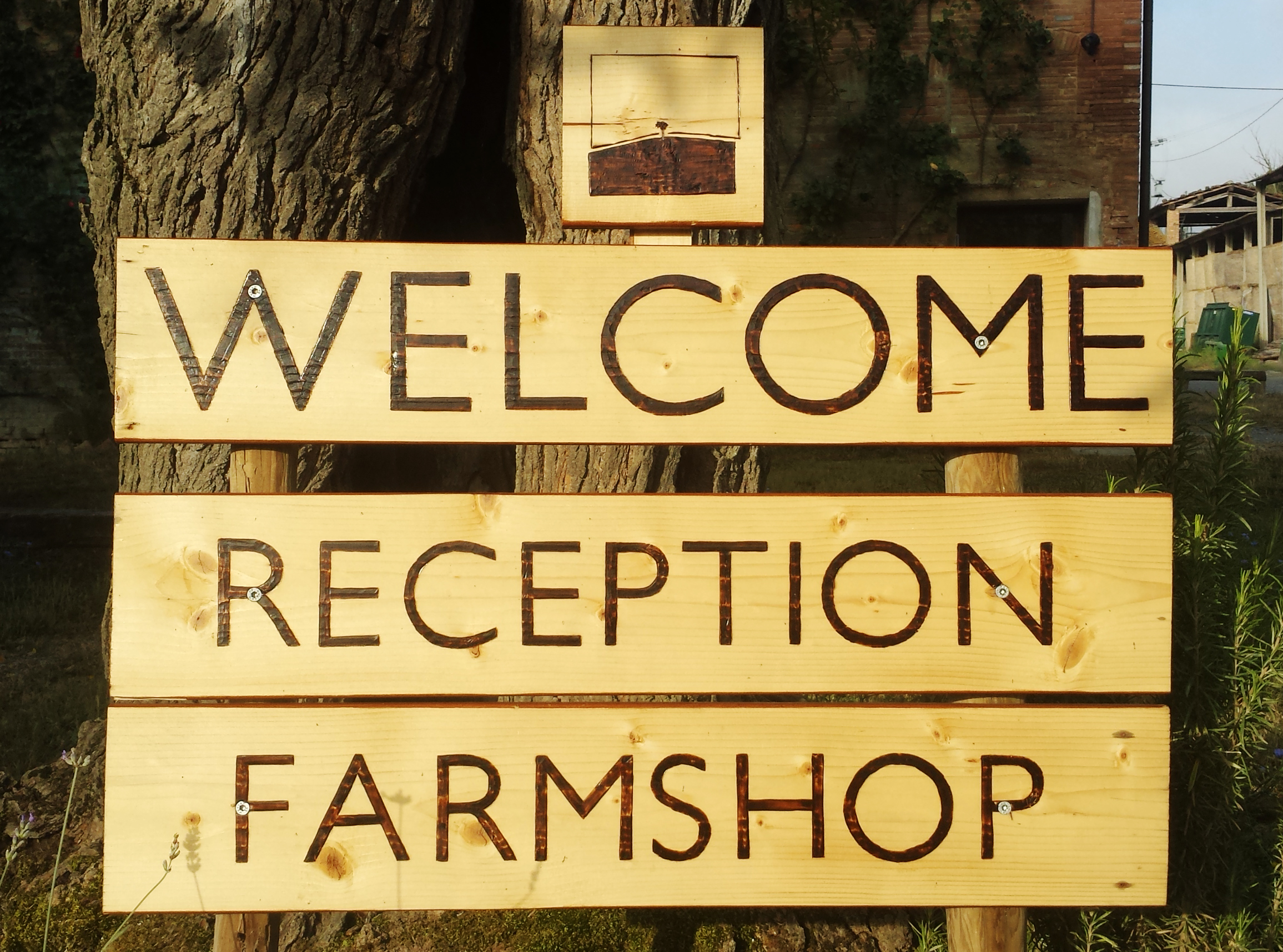 Wood handmade welcome signs at the Reception office of Fattoria Barbialla Nuova