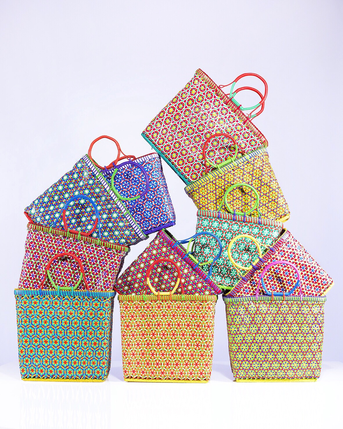 Our beach baskets by Mowgs in every colour of the rainbow,