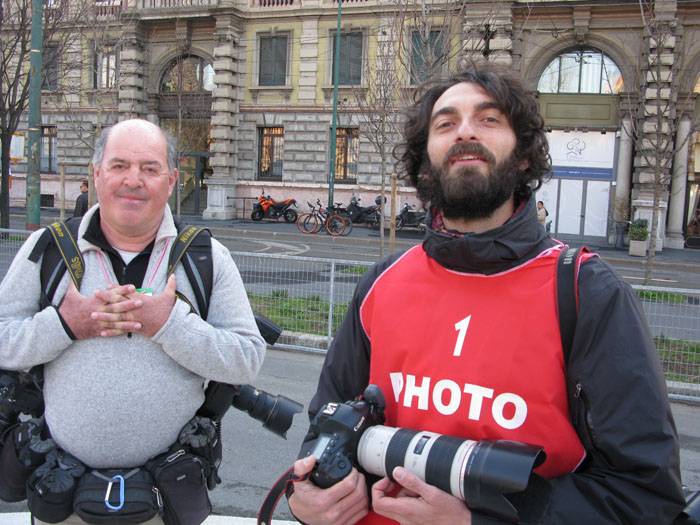 Top cycling photographers Graham Watson (L) and Luca Bettini (R) chill before the beginning of the race