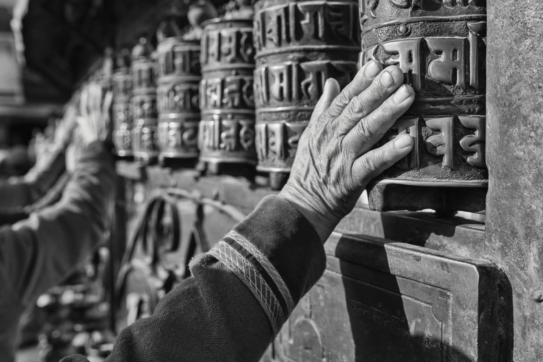 Pilgrims spinning the prayer wheels at the Swayambhu (Kathmandu/ Nepal) - Copyright: Daniel Hofmann