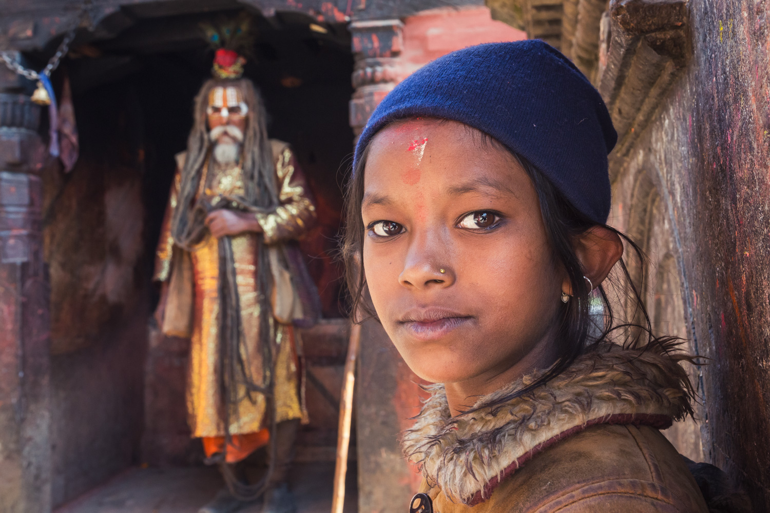Girl in Patan and Sadhu in the background (Nepal) - Copyright: Daniel Hofmann