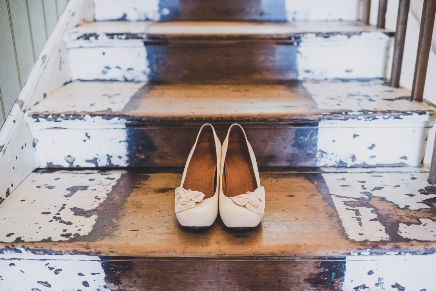 Brides shoes on stairs Fforest wedding