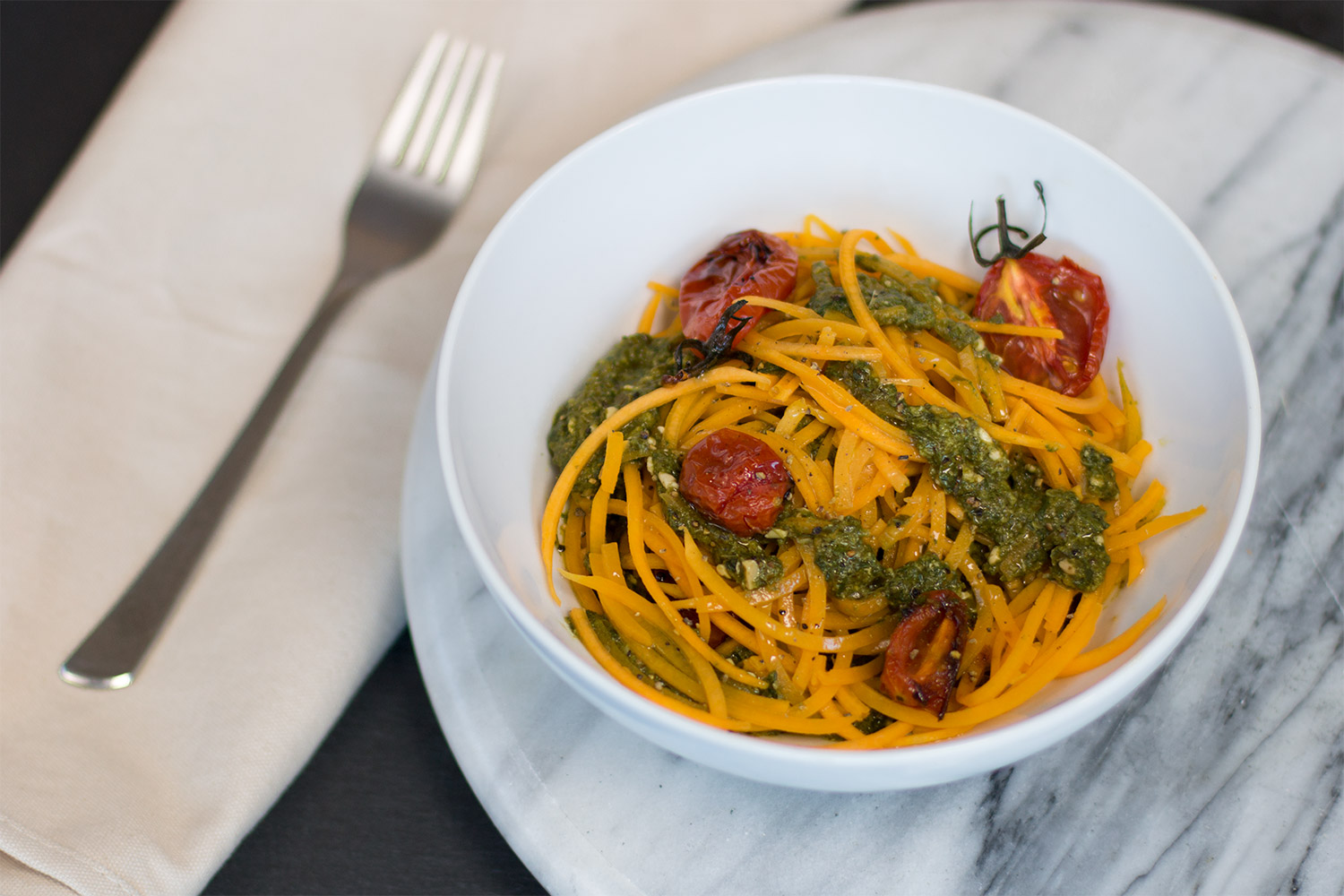 Vegan green basil pesto with roast tomatoes and butternut squash 'spaghetti'