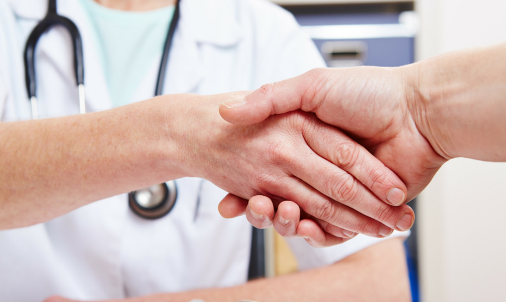 Shaking healthcare provider's hand