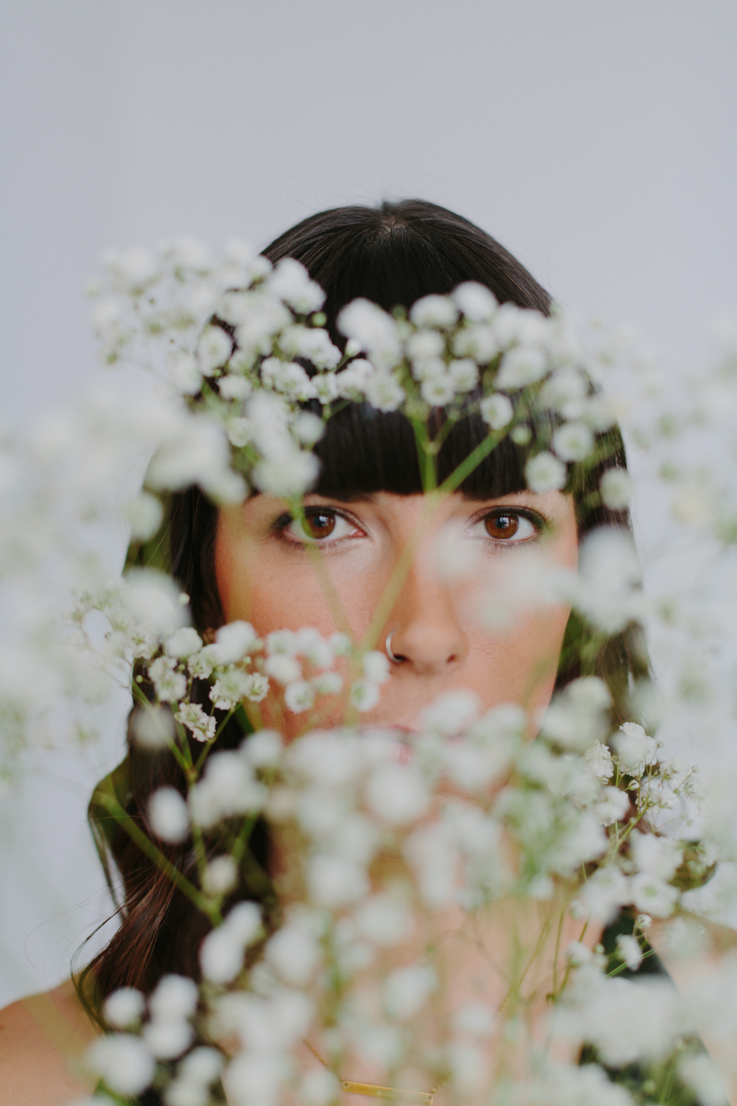 Ashely opted to include plants in her portrait session, by Alexa Mazzarello