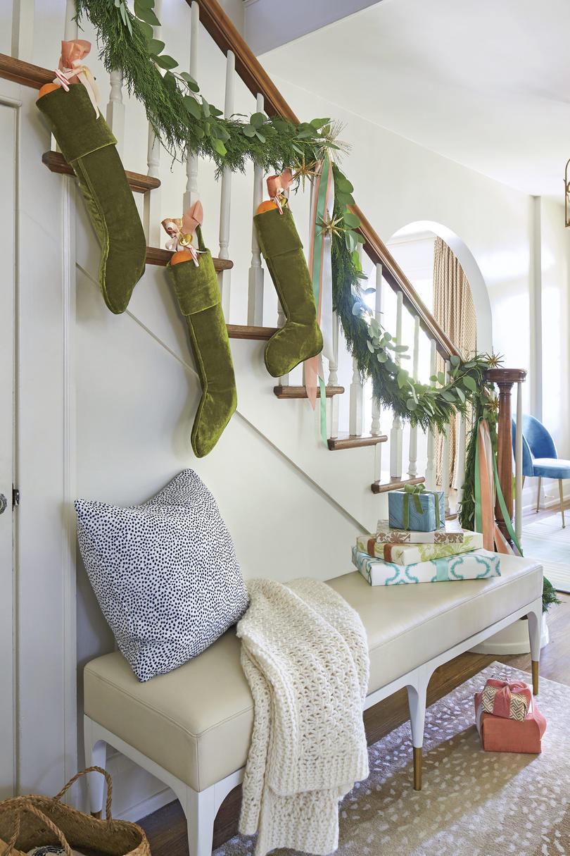 Don't let the living room have all the holiday fun. Make a playful statement in this welcoming area with a garland-draped, stocking-bedecked banister