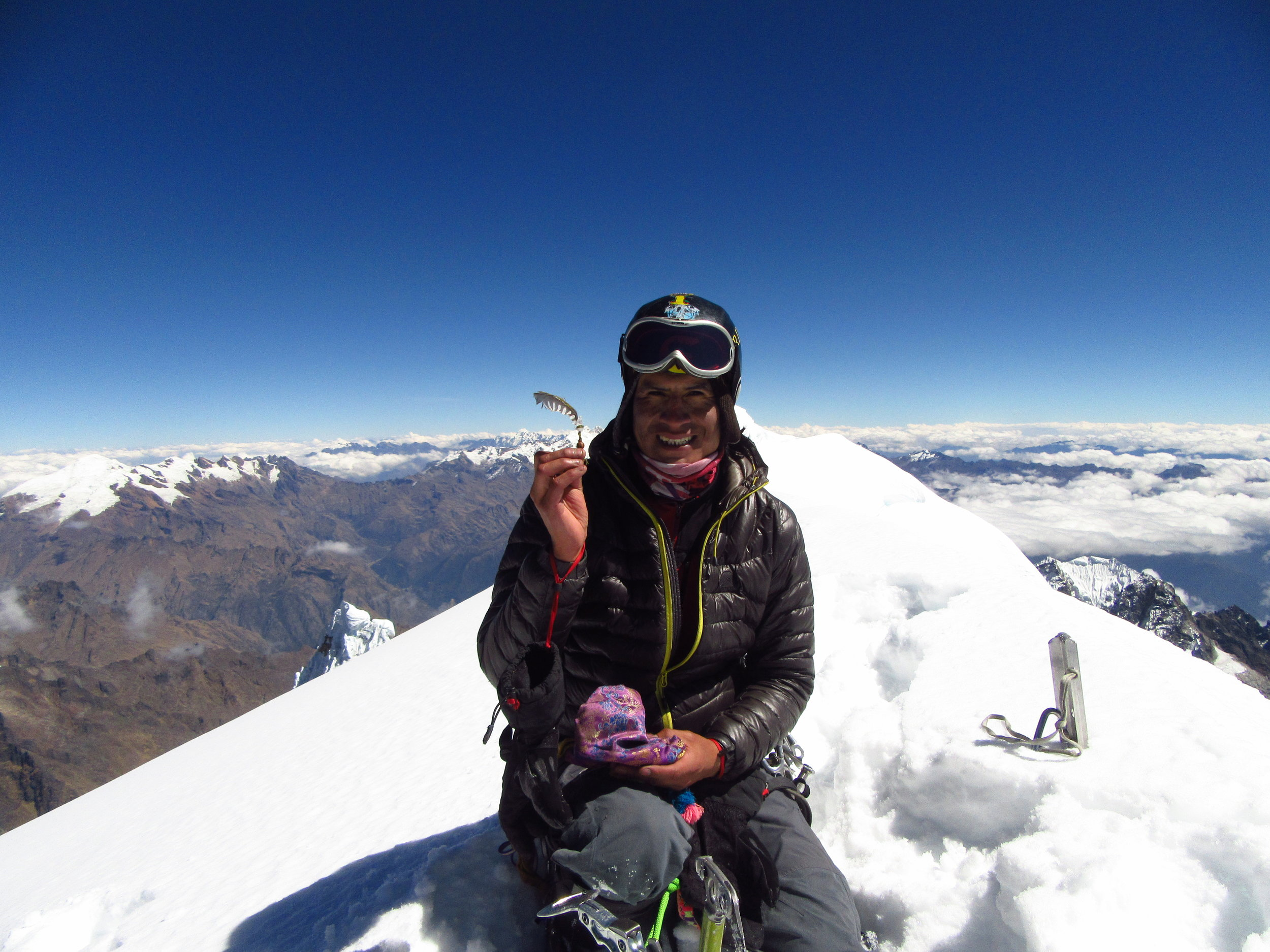 Marco Jurado - IFMGA (UIAGM) certified mountain guide from Huancayo, Peru. Marco loves climbing and hiking in the Cusco region. I took this photo of him on the summit of Salkantay.
