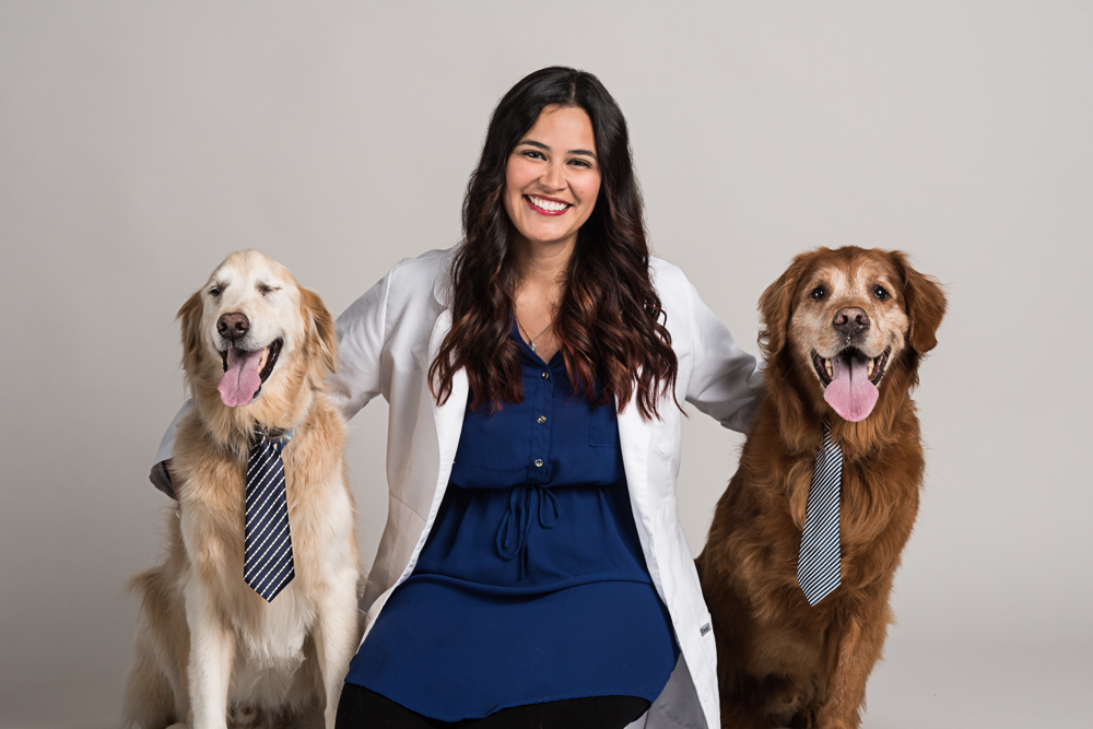Dr. Cordes and her two handsome, senior golden retrievers, Mac and Miller.