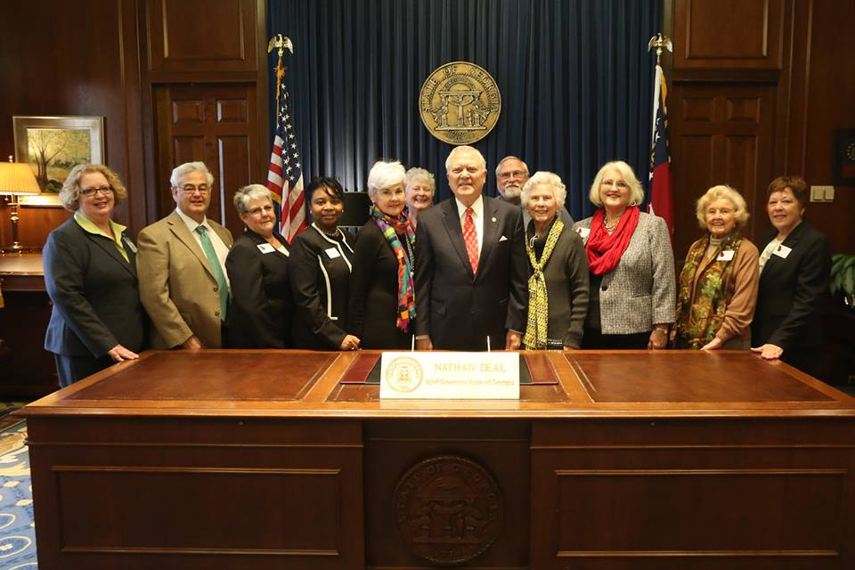 Some Council members with gov. deal during senior day at the capitol 2016.