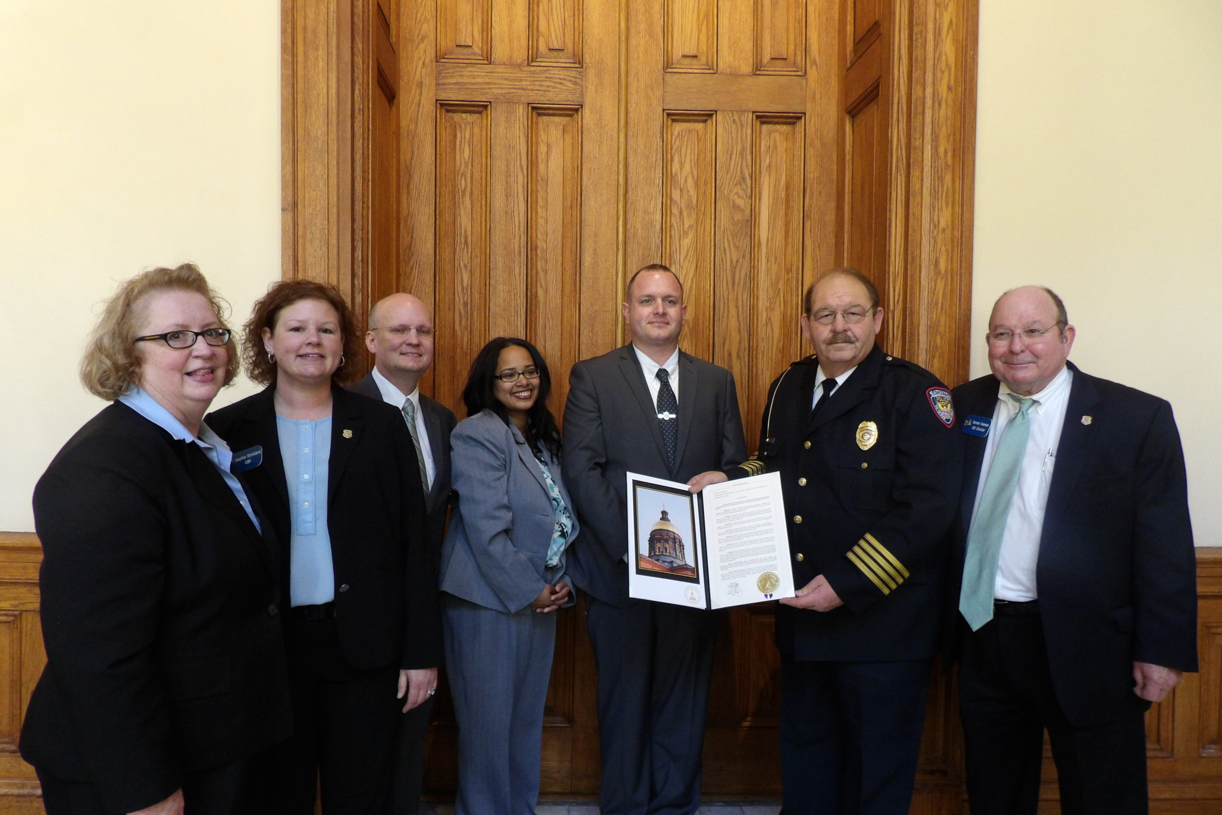 (L-R: Kathy Floyd, GCOA; Heather Strickland, GBI; Jason Marbutt, Cobb County Senior Assistant District Attorney; Erikka Williams, Houston County Chief Assistant District Attorney; Justin Von Behren, Gwinnett County Police Detective; Kent Lawrence, Eatonton Police Chief; and, Vernon Keenan, GBI Director)