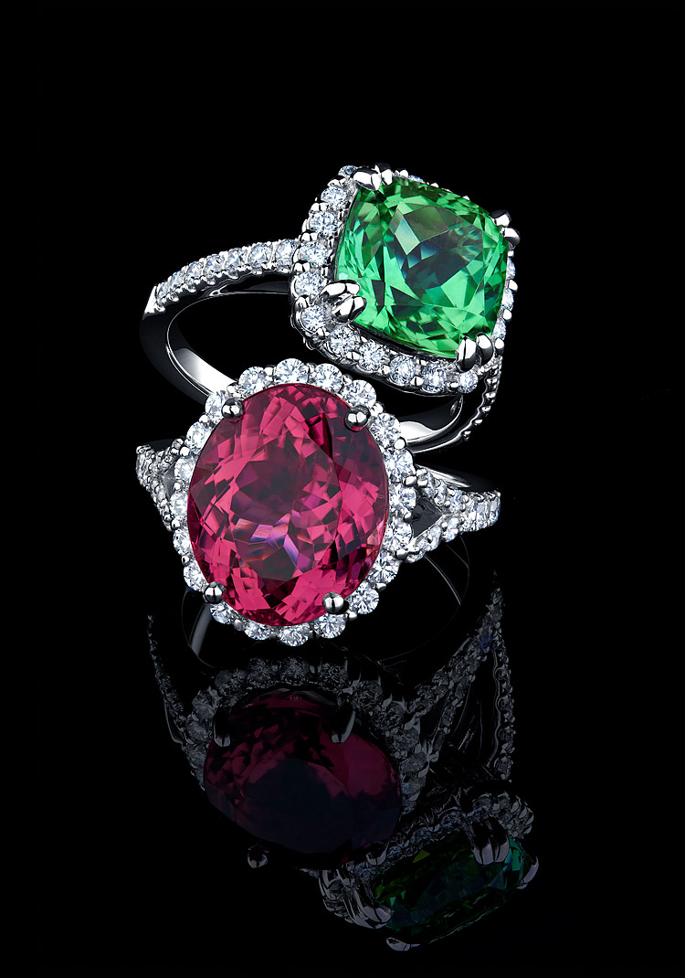 Jewelry photograph of pink and mint tourmaline rings on black