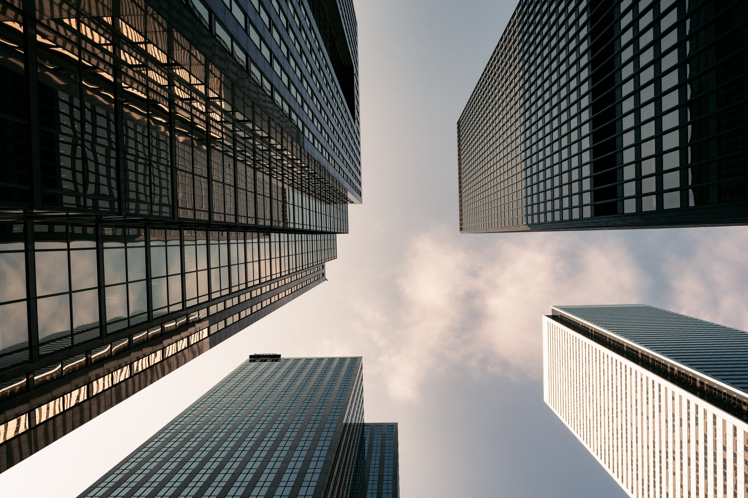 four-buildings-from-below-small-clouds.jpg