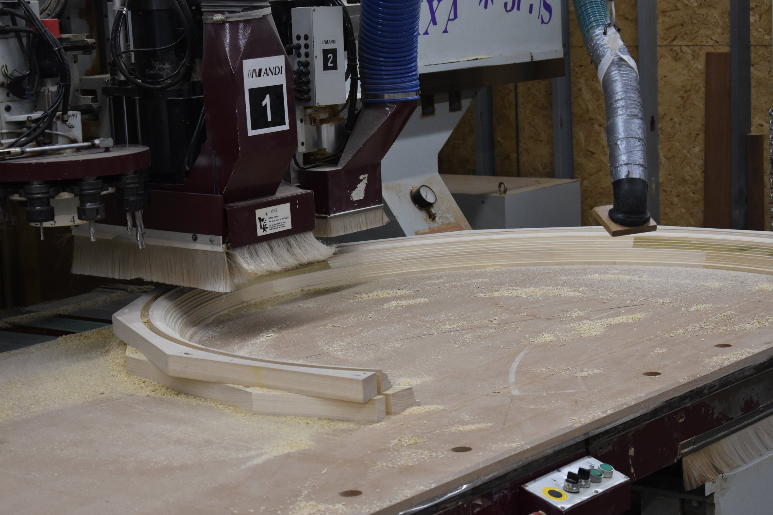 CNC running an arched molding