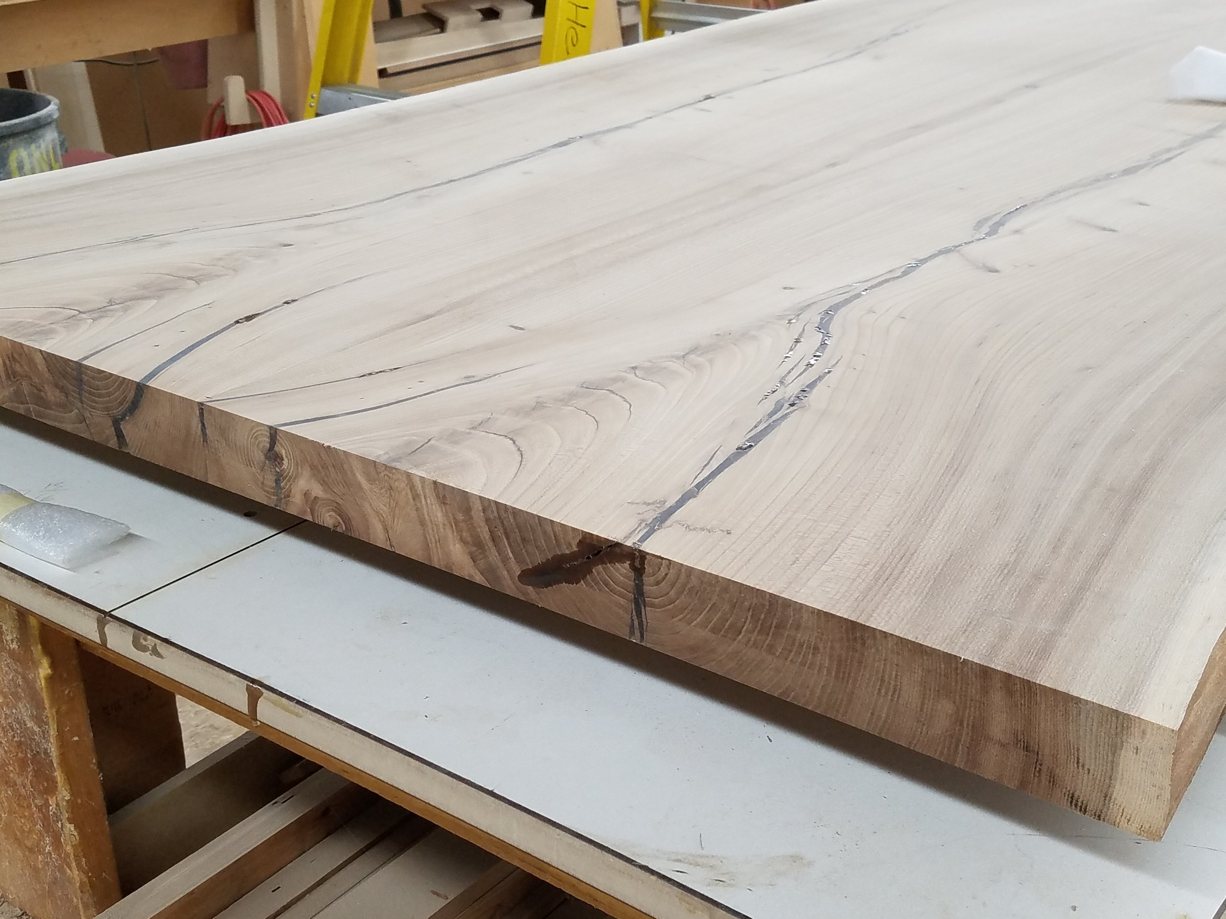 A beautiful slab of elm awaiting transformation into a live-edge dining room table.