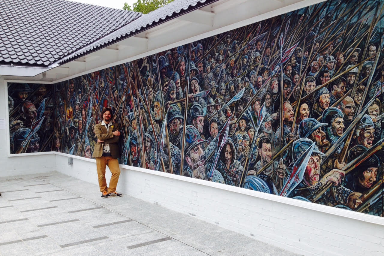 Chris Rutterford - film still from An Audience with Bannockburn   Am I making a film and the mural comes free or the other way around? I have built more than a dozen murals in the last five years, many over 20 meters long. My work in conjunction with editor Mettje Hunneman has become central to my practise. Building films and time lapsing my output galvanises me on a daily basis. The Audience with Bannockburn film we are showing tells the story behind the building of my 2014 Battle of Bannockburn commemorative mural. The process that took over a year and a half and involved hundreds of participants. I think it's our best film yet.    www.chrisrutterford.com