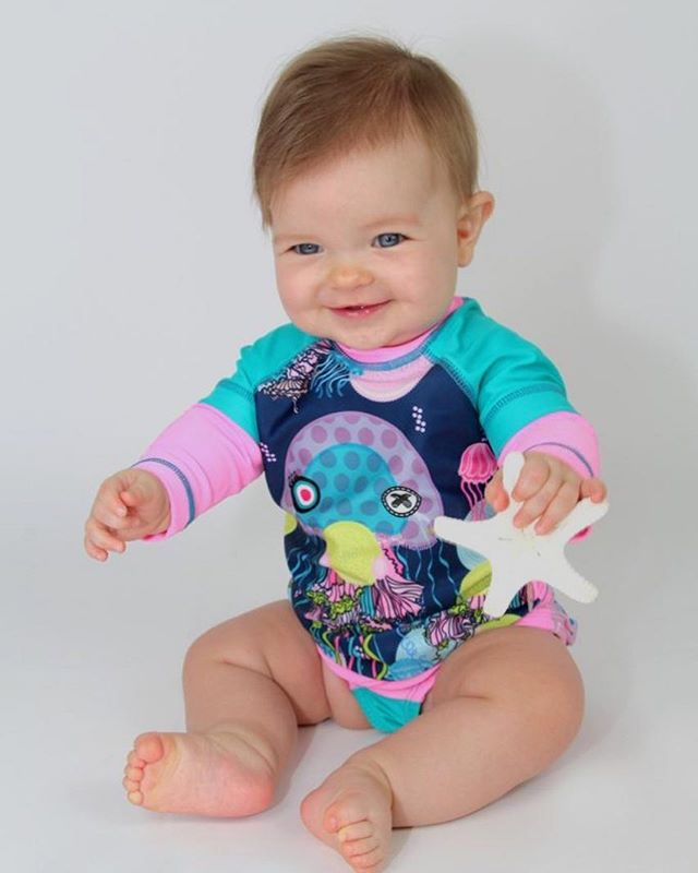 A baby is as pure as an angel and as fresh as a blooming flower 🌸 •  This cute little one is wearing our SPF 50 jelly fish rash guard that allows your little one to have fun in the sun and be protected from the harmful rays 🌞 • • • #kriocolor #kriocolorswimwear #kriocolortips #funinthesun #ilovekrio #miamiswimshow #spf50 #childrenwears #kidswear #fashionblogger