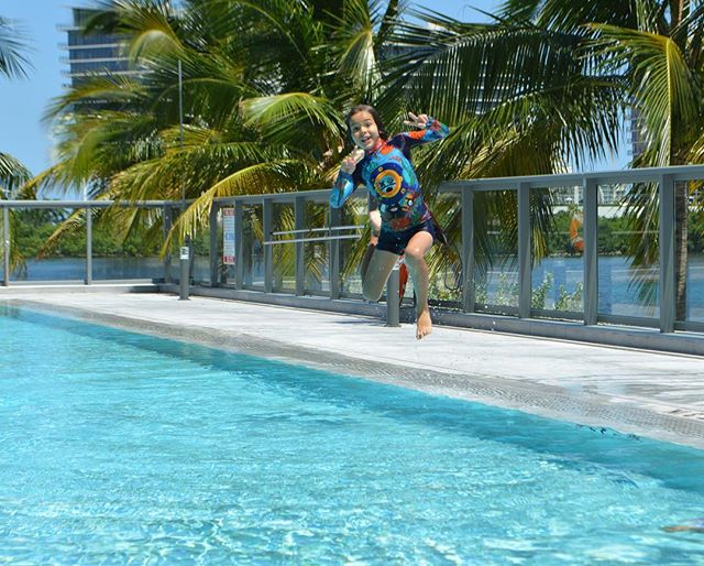 Ready, Set, JUMP!!! 🗣 • These brothers are making a splash in the CaneDiver rashguard and sunsuit ☀️ • • • #kriocolor #kriocolorswimwear #upf50 #swimwear #kidsfashion #babyfashion #children #funinthesun #jump #summertime #summerkids #twinningbros