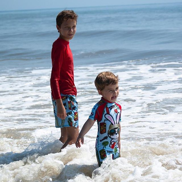 All you need is a good dose of vitamin sea 🌊 • Big brother is wearing solid red rash-guard with veggie trunks! Little brother is matching with his Bunny Veggie boy sunsuit! • • • #kriocolorswimwear #kriocolor #summer #kidsfashion #kidsswimming #kids #childrenswear #kidsswimwear #upf50 #miami
