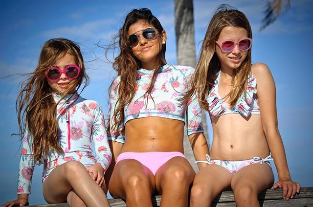 The sun is shining and so are you! Protect your skin and your little ones too ✨ with KrioColor Bikinis, Bodies, Rashguards, Sunsuits! 🌞 •  DM for mommy & me matching swimwear! •  Coral Reef Sets UPF50: body with front zipper, teen crop top with solid pink coral bottoms, bikini with ruffles set🌸 • • #kriocolorswimwear #kriocolor #kriocolortips #upf50 #teenswim #childrenswear #kidsfashion #kidsswimming #girlsswimwear #summer #summerisntoveryet