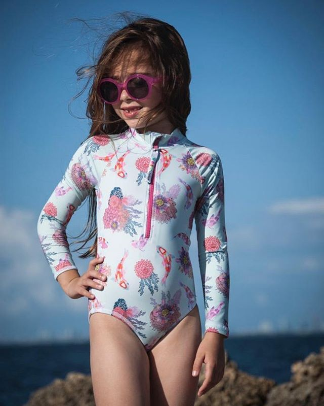 FREE SHIPPING IN USA❗️❗️ (limited time offer)  Sunshine and happiness go together like the outdoors and Krio! 🌞😀 •  @avisimasanz is rocking the coral reef body rash guard •  #kriocolorswimwear #freeshipping #upf50 #swimwear #childrenfashion #kidsfashion #swimminglessons #kids #funinthesun