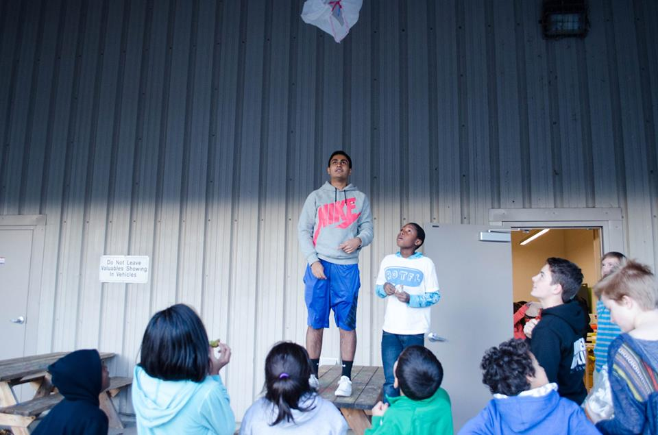 Coach Arjun and Pierre test their parachute.